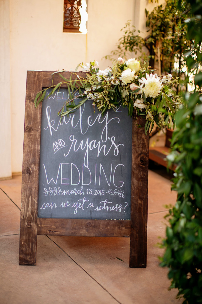 Chalkboard easel sign for wedding ceremony