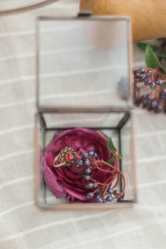Glass box with garnet wedding ring