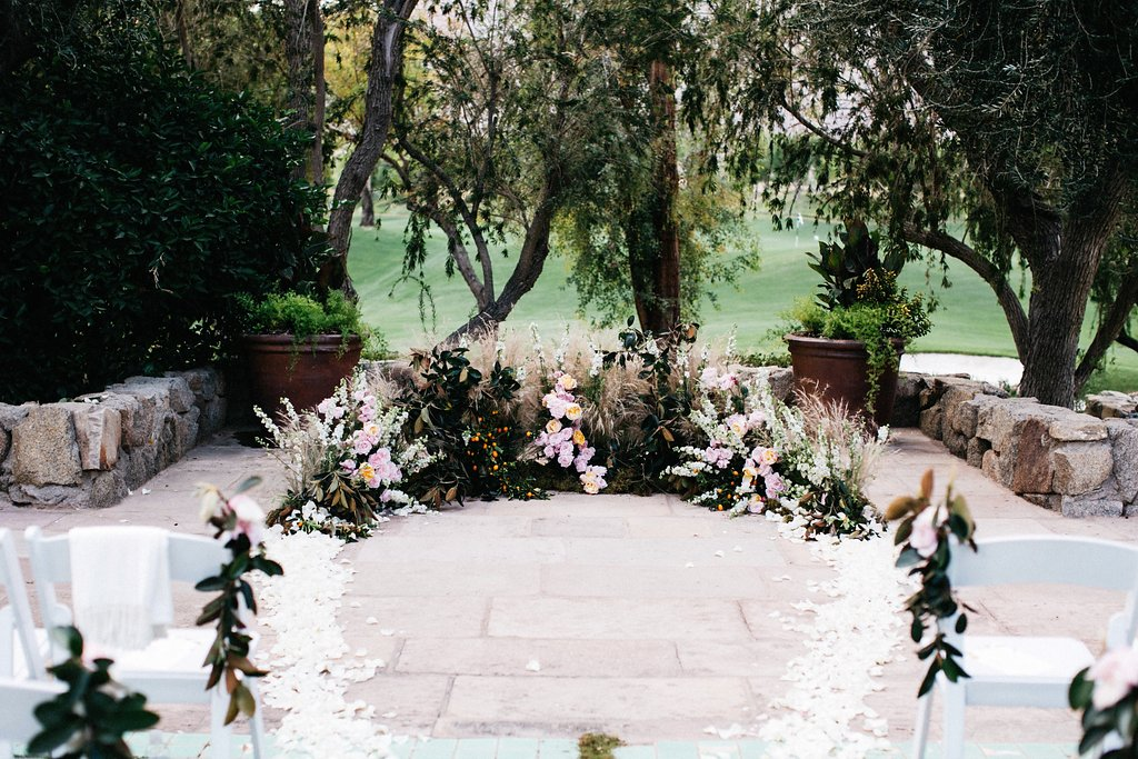 Custom floral arch on the ground