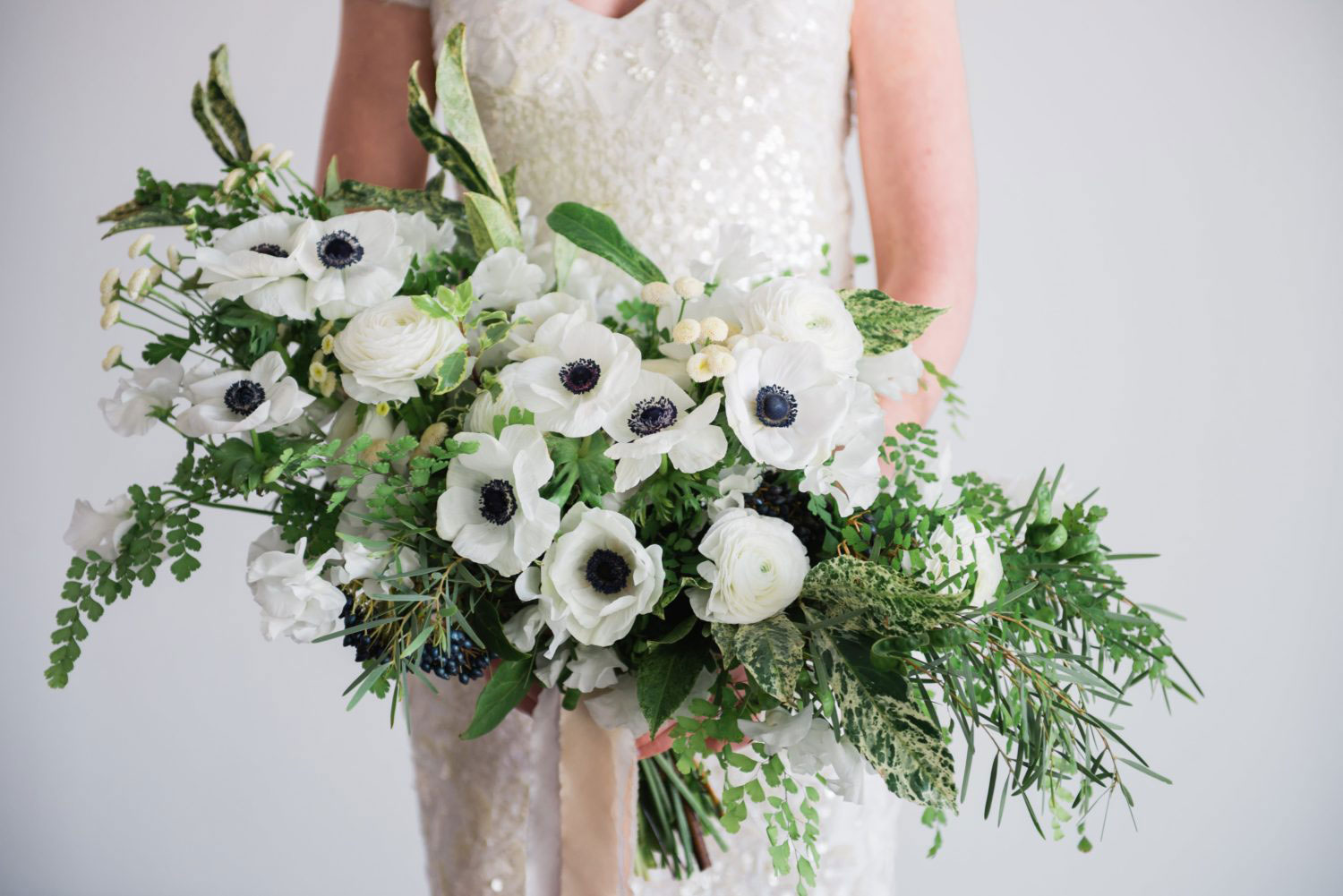 White and poppy bridal bouquet