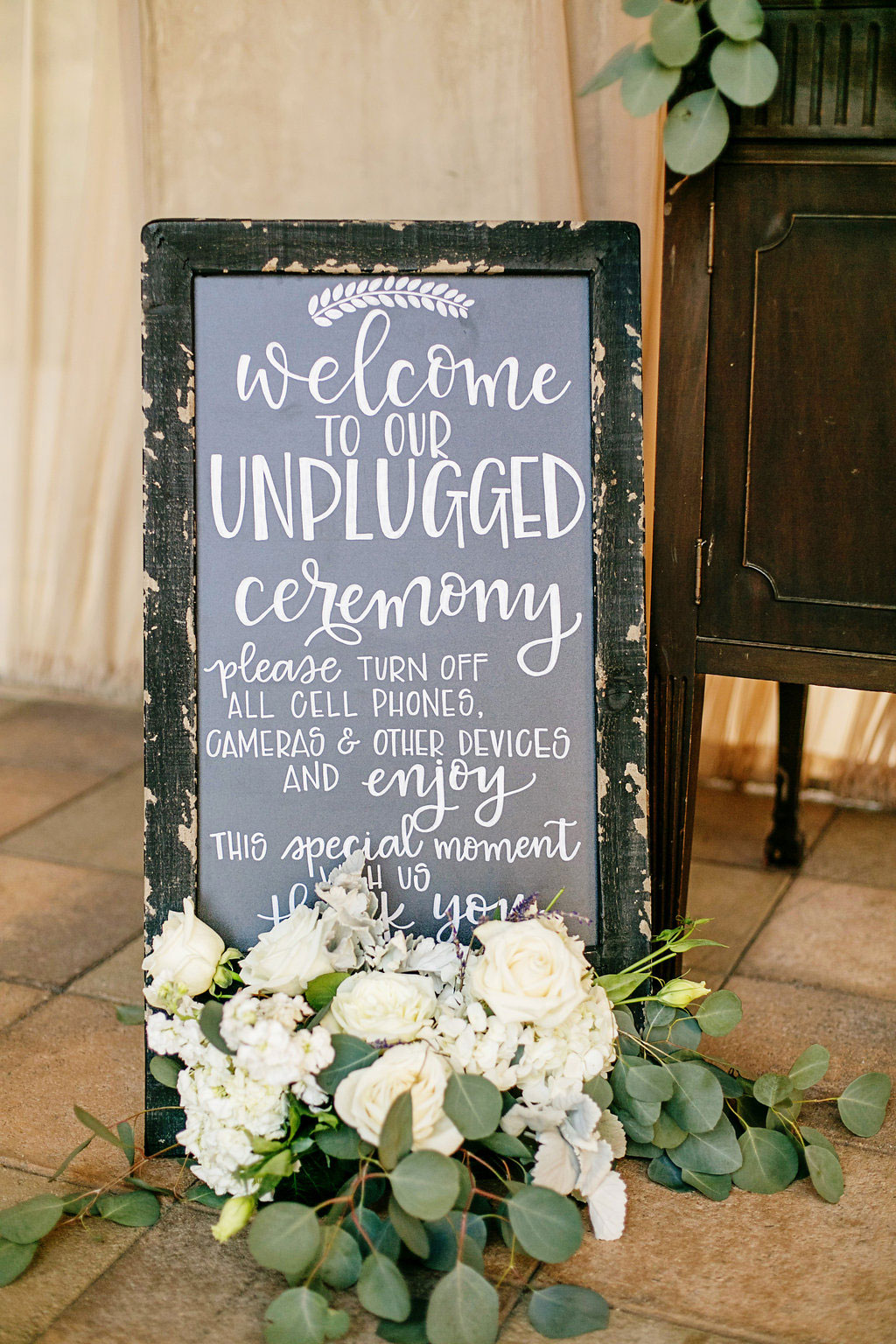 Chalkboard unplugged ceremony sign at Serra Plaza wedding in Orange County