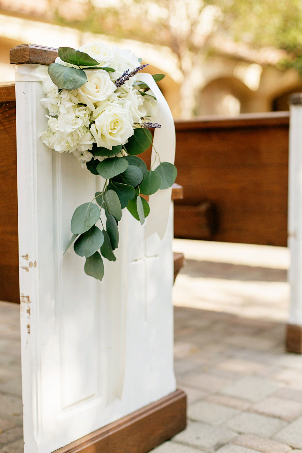 Wooden church pews in Serra Plaza Orange County Wedding