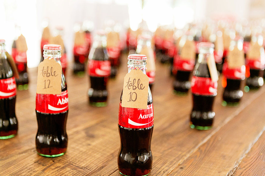 Custom coke bottle escort cards at Serra Plaza wedding in Orange County by Lucky Day Events Co. and Chard Photography