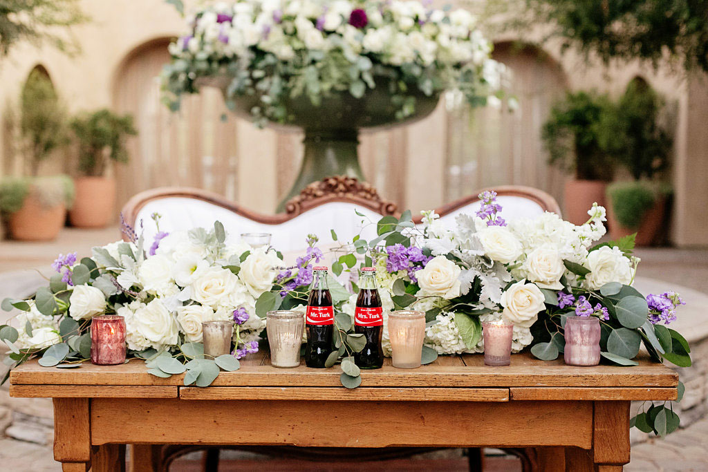Custom coke bottle lilac head table at Serra Plaza
