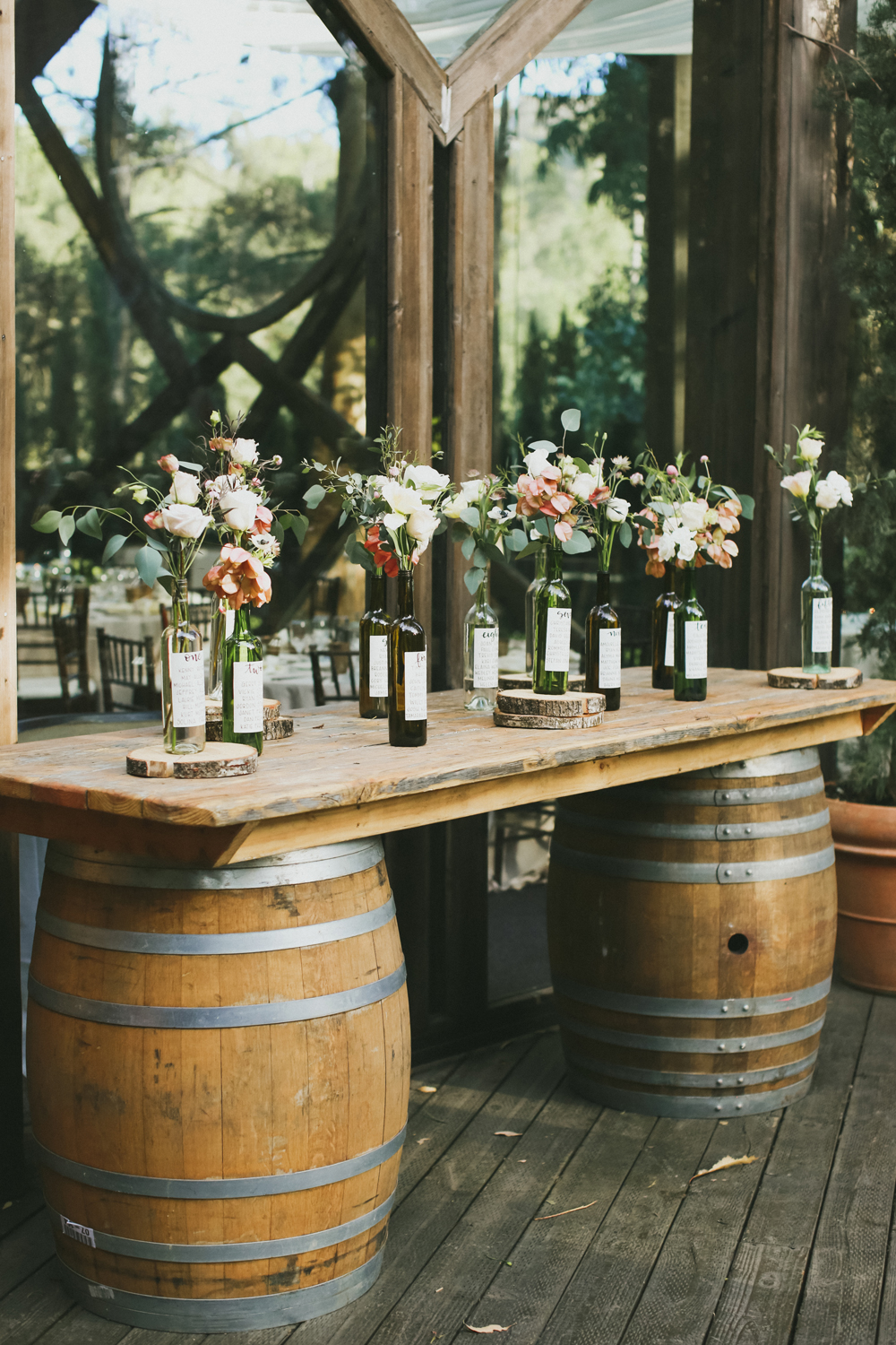 Glass bottle table numbers with flowers