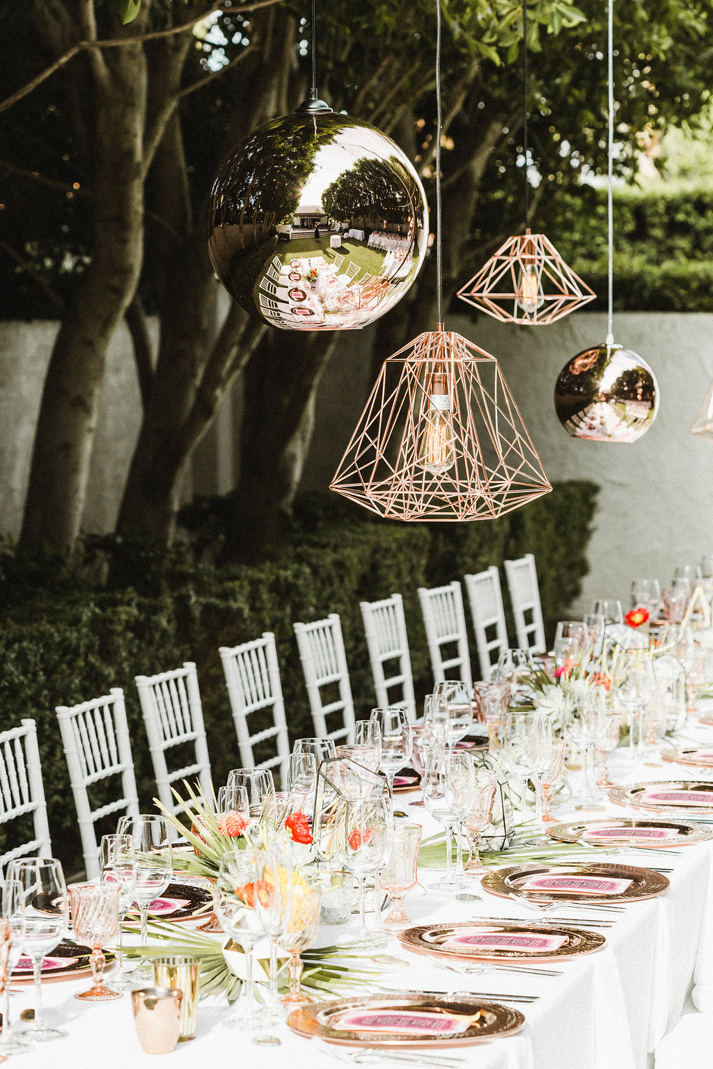 Avalon Palm Springs Wedding Reception with copper lanterns and copper table settings.