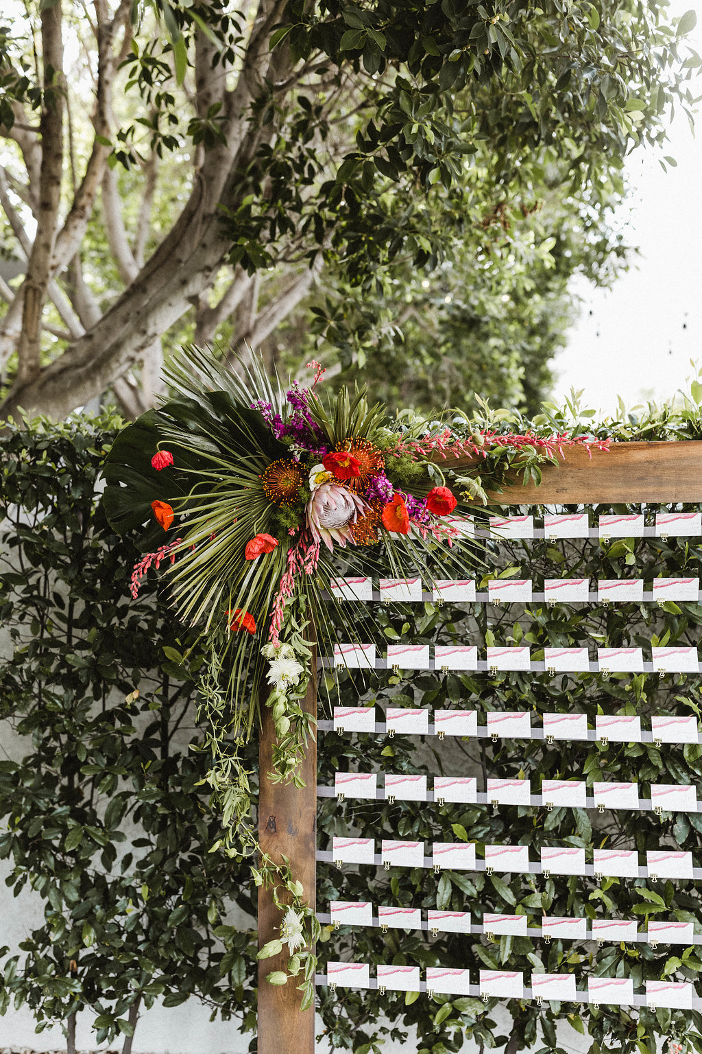 Avalon Palm Springs Wedding Bright Flowers on Escort Wall. Custom Escort Card Display.