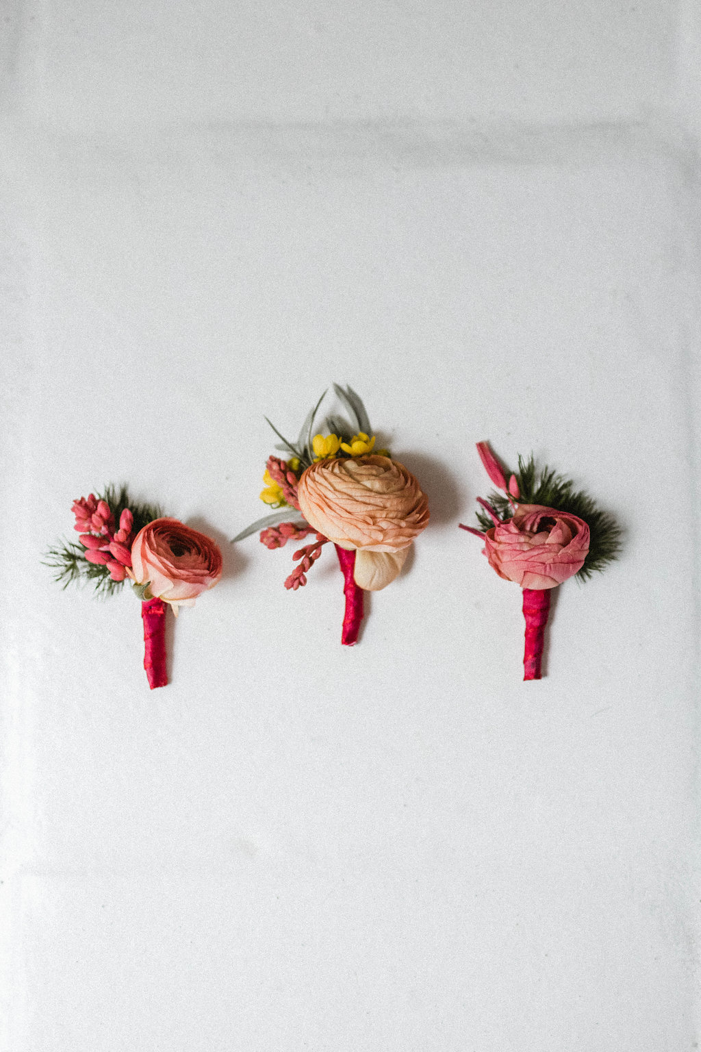 Bright bridal party boutonnieres