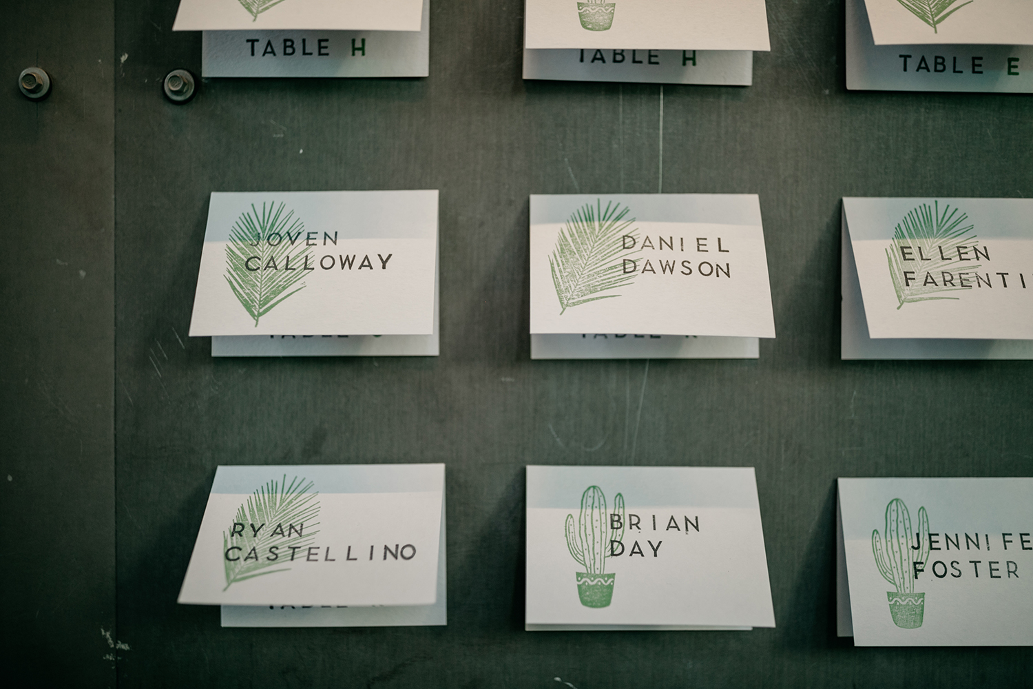 Modern cactus stamped escort cards at an industrial Millwick Wedding in Los Angeles