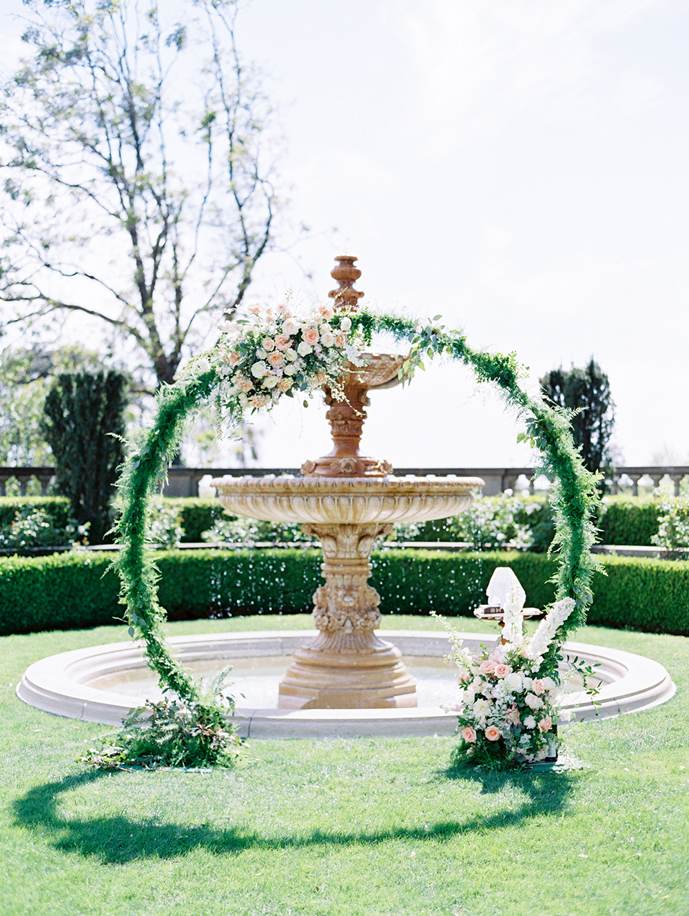 Romantic and Classic Greystone Mansion Wedding by Lucky Day Events Co. x Jordan Galindo Photography // Circular Arch for Ceremony with Blush Flowers