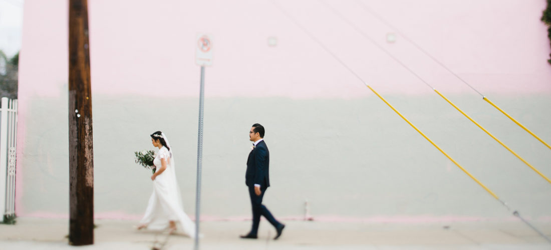 Modern walking photo with bride and groom
