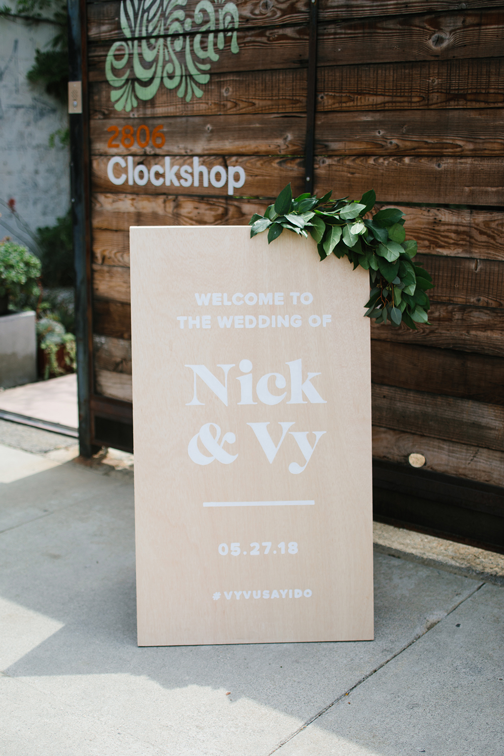 Wooden wedding welcome sign with modern writing