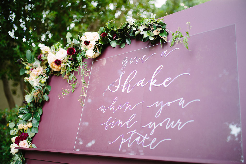 Acrylic sign on escort wall for wedding