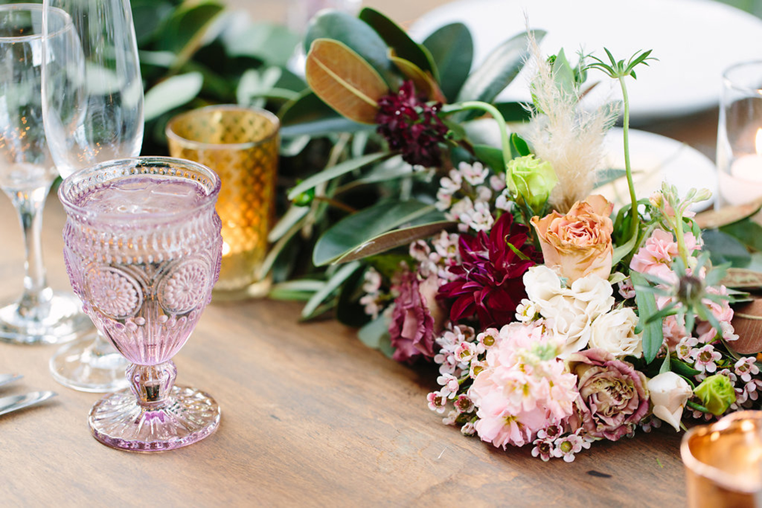 Burgundy wedding reception flowers