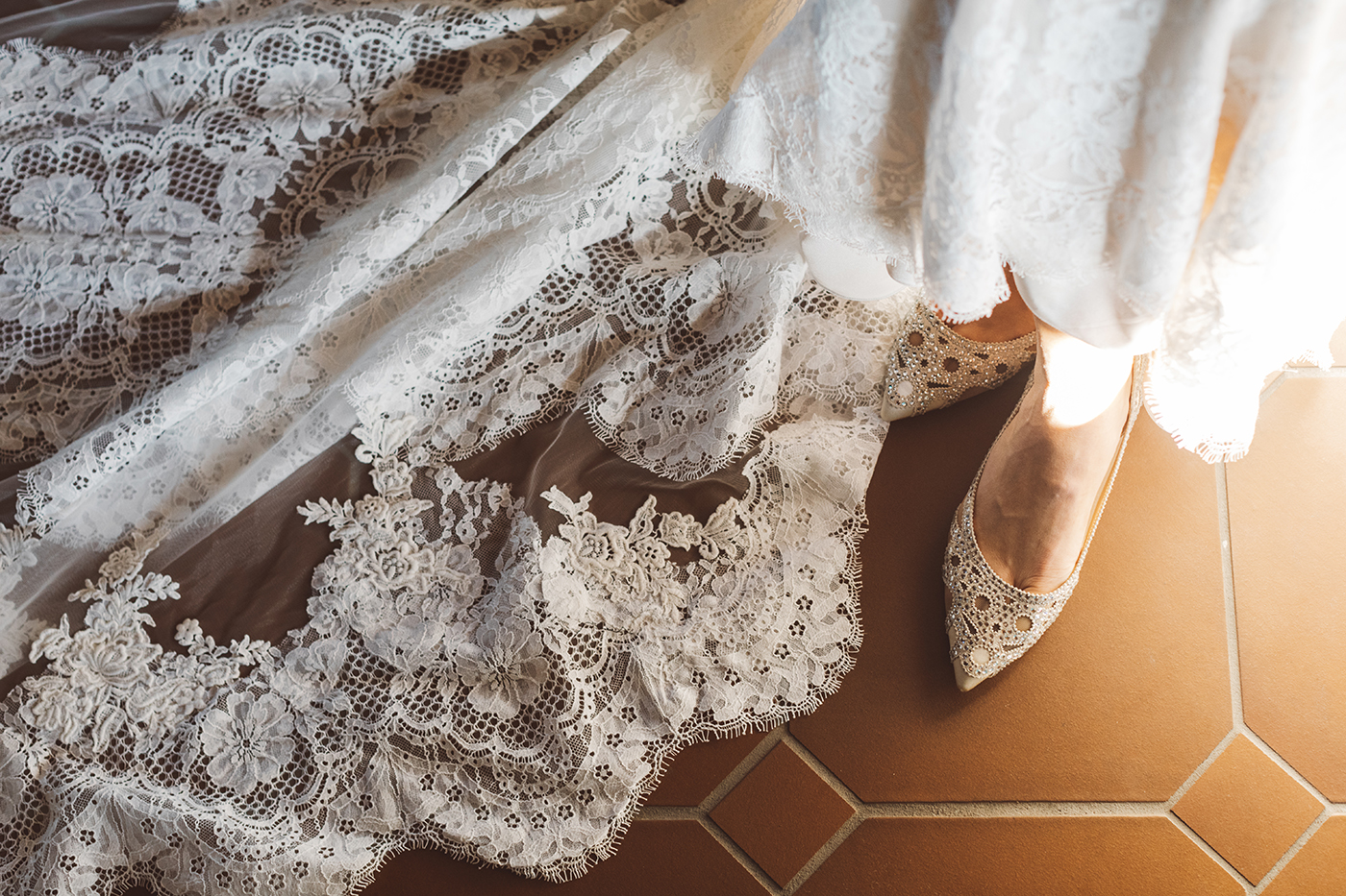 white lace wedding dress and shoes
