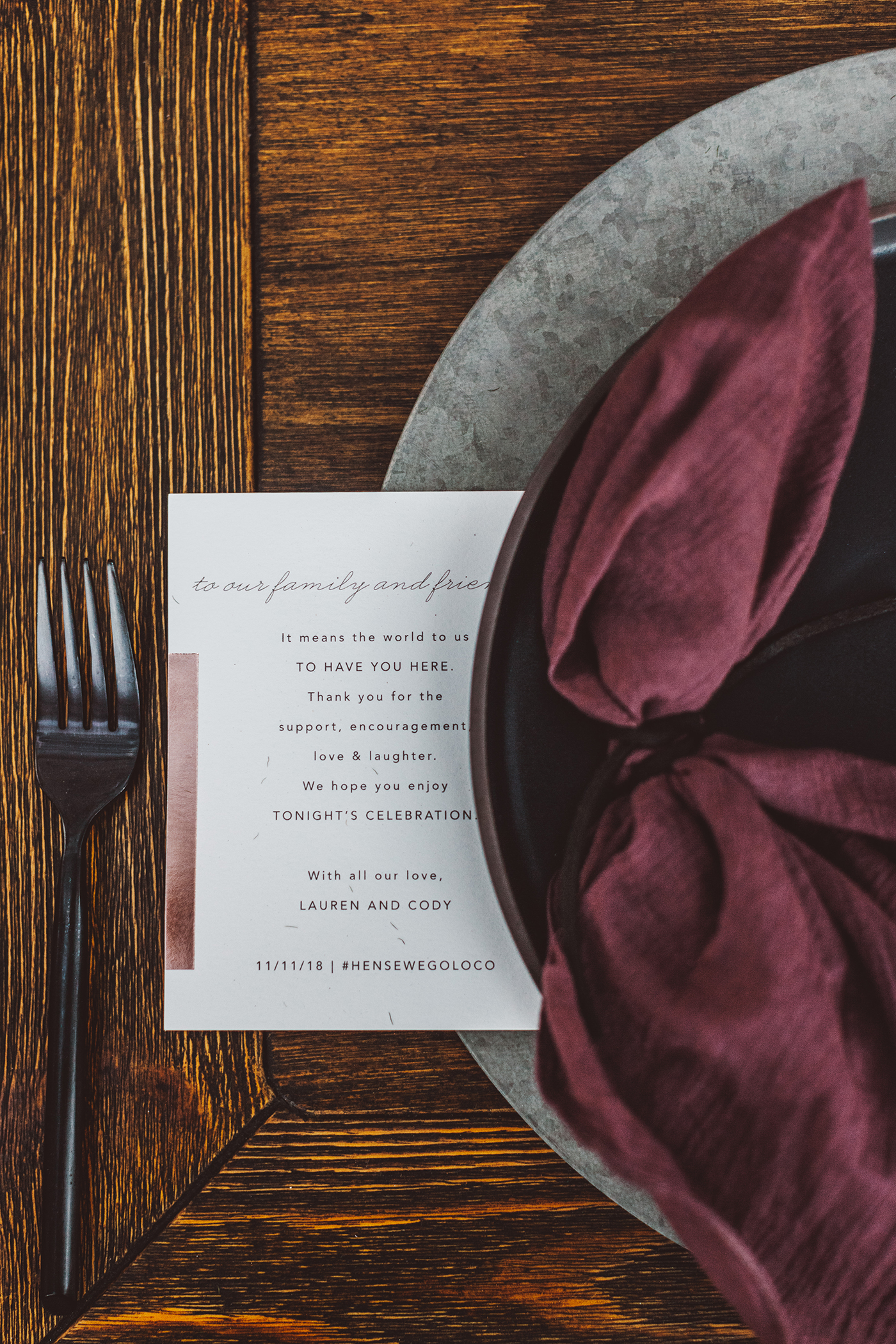 Burgundy and metal table settings