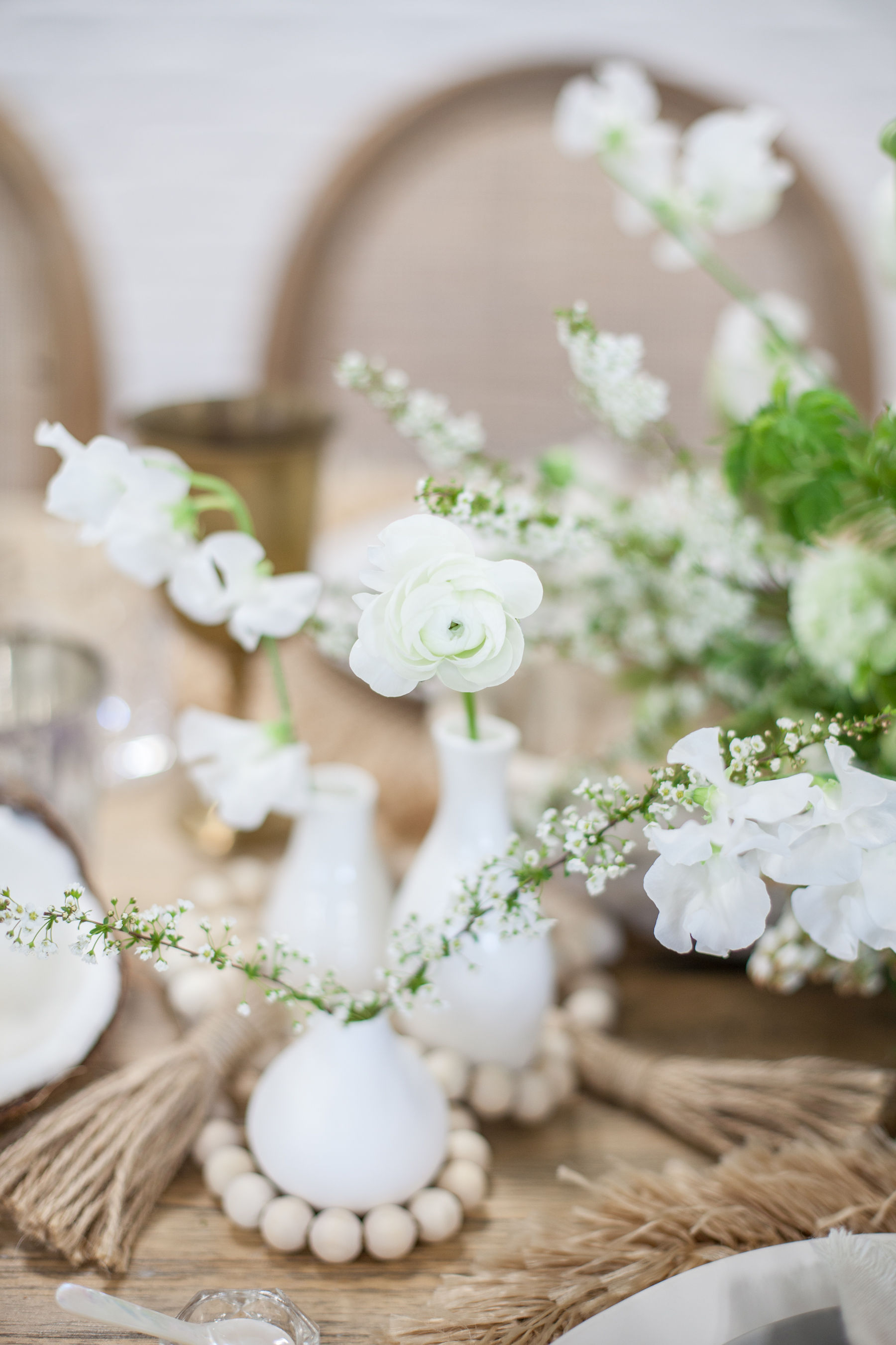 White bud vases with minimal white flowers