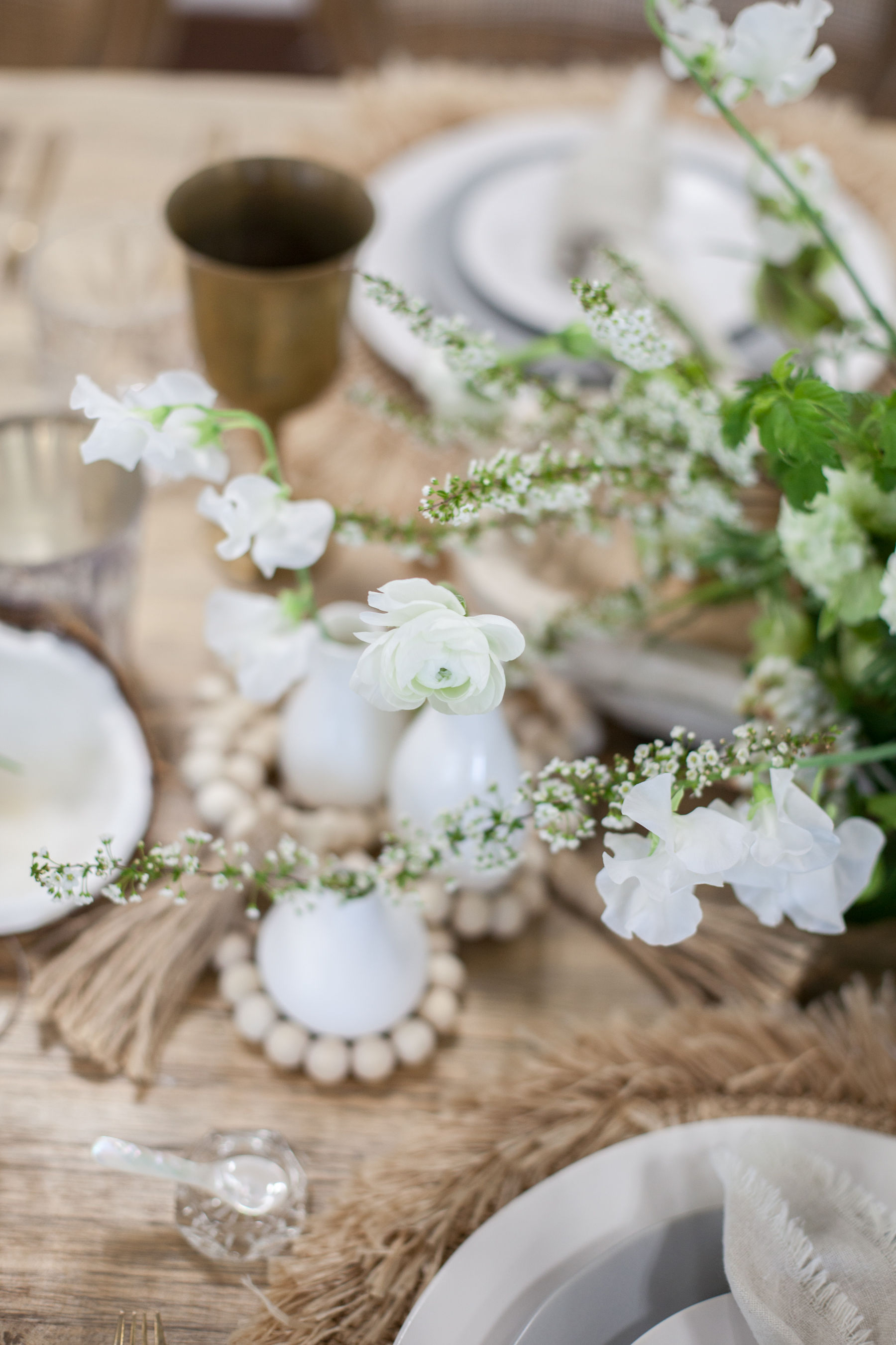 Wooden beads and white bud vases