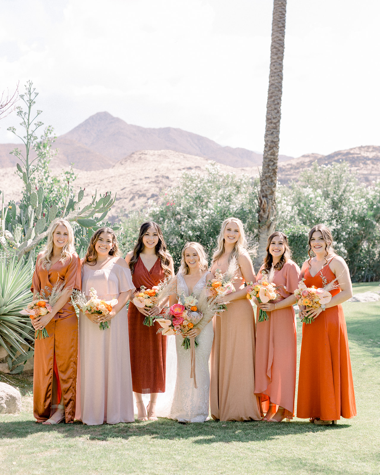 Rust orange bridesmaid dresses at colorful Palm Springs wedding by Lucky Day Events Co. Our Story Creative