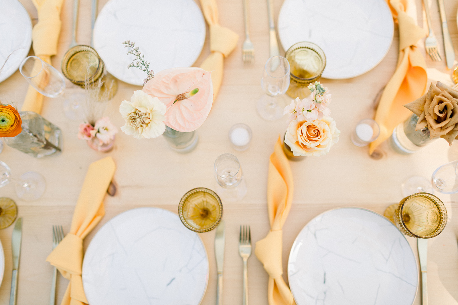 Marble plates and orange napkins at colorful Palm Springs Wedding by Lucky Day Events Co. x Our Story Creative