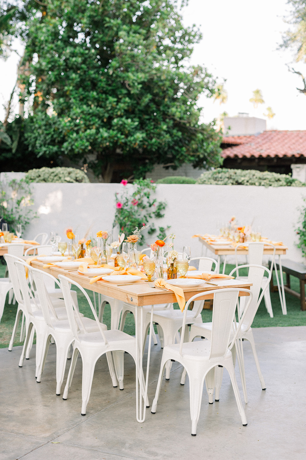 White bistro chairs for an outdoor Palm Springs Wedding