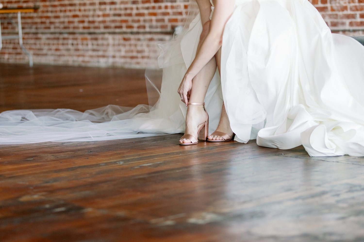Bride Putting On Wedding Shoes Photo
