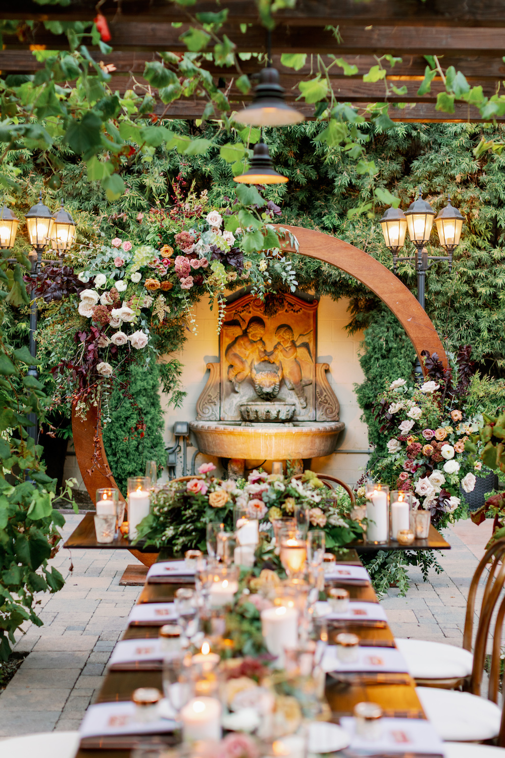Wooden Circle Arch with Burgundy Flowers.