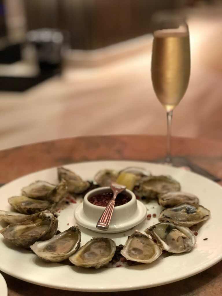 Oysters and Champagne at Camellias Champagne Bar at Hotel Bennett Charleston South Carolina Lucky Day Events Co.