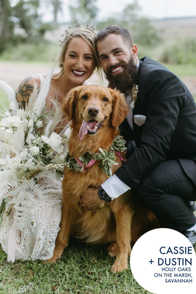 Bride and groom with golden retriever at their wedding